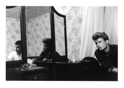 Larry Clark, Untitled (two men and mirror), c. 1970, printed 1980, Gelatin silver print, 8 1/2 × 12 5/8 in (21.6 × 32.1 cm)