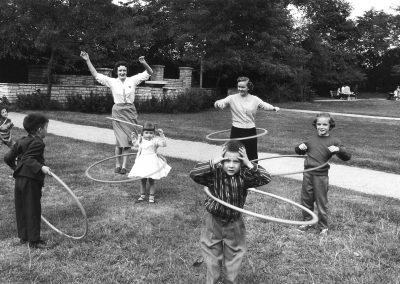 Mickey Pallas, Hula Hoopers, Chicago, 1958, Gelatin silver print, 7 7/8 × 12 in (20 × 30.5 cm), contact gallery for price