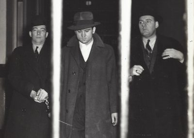 Weegee, Suspect Taken to Jail, c. 1940, Vintage Silver Gelatin Print, 6 1/2 x 4 3/4 in., (16.5 × 12.1 cm), Please credit Weegee from Photo Representatives stamp in black ink on verso