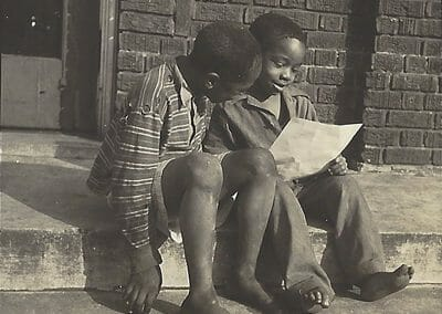 Gordon Parks, Untitled (two boys reading), Gelatin silver print, 2 1/2 x 2 1/2 in., contact gallery for price