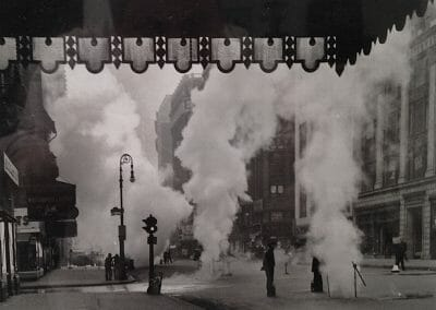 "Weegee,  Untitled (steam shooting up Broadway, under Marquee of the Metropolitan Opera House), July 1940, Vintage Silver Gelatin Print, 6 1/4 x 8 1/4 in., New York News Daily stamp, Arthur Fellig address stamp, Date stamp, Delivered Wide World Photos time stamp, date stamp all in red ink and Art Dept date stamp in black ink; annotated ""BWay Flood,"" Steam shooting up B'Way"" ""Photo made from underneath Marque of Metropolitan Opera House"" ""3 col art Gas Main"" in pencil and ""Daily"" in black crayon; headline of New York Times article adhered to verso, Published in The New York Times on July 4, 1940."