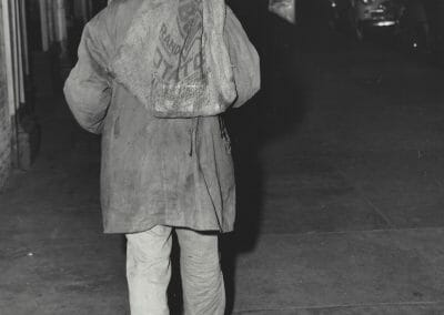 Weegee, Man carrying burlap bag on his back, New York, c. 1950, Vintage Silver Gelatin Print, 10 x 8 in.