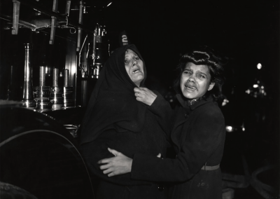 "Weegee, ""I Cried When I Took This Picture,"" Ms. Henrietta Torres and Her Daughter Ada Watch as Another Daughter and Her Son Die in Fire, December 15, 1939, Silver gelatin print, printed in 1981 by Sid Kaplan 16 x 20 in., From the ""Weegee Collection"" portfolio printed in 1980. Only three complete sets printed out of the edition of twenty, plus various additional prints of certain images. ""Weegee Collection"" embossed blindstamp in border corner."