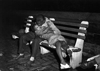 "Weegee, Lovers on Park Bench, c. 1940, Silver gelatin print, printed in 1981 by Sid Kaplan, 12 1/2 x 16 1/3 in., Weegee Collection embossed blind stamp in lower border on recto. Notated 6/3 in lower left quadrant in pencil on verso. From the ""Weegee Collection"" portfolio printed in 1980. Only three complete sets printed out of the edition of twenty, plus various additional prints of certain images, Full negative"