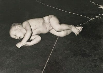 """Roger Ballen, Untitled, Sleeping Baby, 2000, Vintage selenium toned gelatin silver print, 14 4/16 x 14 2/16 in., Photographer's signature, title, date, edition, and medium in pencil, annotated """"Edition 4/35"""", """"printed 2000"""", """"shot 2000"""", """"Ilford Gallery, Fibre Based"""", """"selenium toned"""", """"GOOD SPOT TONED (1)"""", and """"5790-RBA P311/4"""" in pencil on verso."""