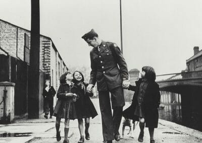 "Robert Capa, London, England, American soldier with war orphans ""adopted"" by his unit, 1943, Vintage silver gelatin print, 5 10/16 x 7 4/16 in., Magnum Stamp with description and illustration information stamp, copyright Robert Capa/ Magnum photos stamp, annotated ""P.201.5.30"" in pencil on verso."