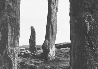 "Paul Caponigro, Callanish Stone Circle, Hebrides, Silver gelatin print, 13 4/12 x 10 in., Photographer's signature and title in pencil, label adhered with annotated ""11.D 1"" in black ink on verso."