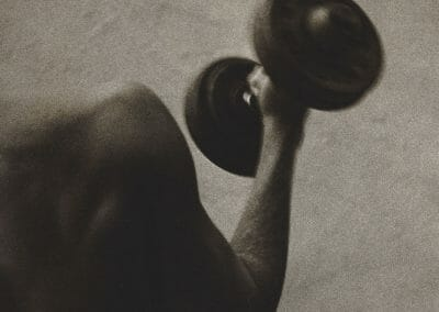 "Ralph Gibson, Untitled (Barbell), Vintage silver gelatin print, 7 1/2 x 5 in., Two of Photographer's stamps, annotated ""222 W. 23rd St. New York-NY U.S.A"" in black ink on verso."