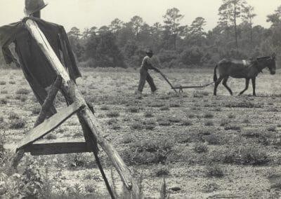 Rosalie Gwathmey, Untitled (Ploughman and Scarecrow), Vintage silver gelatin print, 6 11/16 x 9 in., Rosalie Gwathmey Photographer 1 West 68th St., N.Y.C. Phone Schuyler 4-3177 stamp on verso.