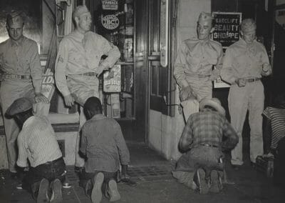 Rosalie Gwathmey, Untitled (Servicemen and Shoeshines), Vintage silver gelatin print, 7 10/16 x 9 6/16 in., Photographer's signature in blue ink on verso.