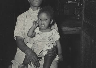 """Rosalie Gwathmey, Woman and Child, Vintage silver gelatin print, 9 1/2 x 7 9/16 in., Photographer's signature in black ink, Photographer's N.Y.C. stamp, annotated """"Rosalie Gwathmey 240 W. 14th St New York City Speed Graphic 3 1/4 x 4 1/4 Film- Super xx: 1/100 see =22 Wabash on camera"""" on verso."""