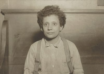 "Lewis Hine, Untitled (Boy with Overalls), Vintage silver gelatin print, 4 1/2 x 6 10/16 in., Annotated ""448"" in pencil on verso."