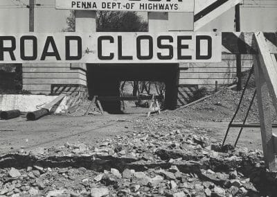 """Gordon, Parks, Paoli, Pennsylvania, Vintage silver gelatin print, 7 1/2 x 7 1/2 in., Photographer's signature in pencil, label adhered reading """"Pennslyvania 34118 Paoli, Pa. Detour sign on U.S. highway 202."""" Please Credit Standard Oil Co. (N.J.) stamp, Please return unused photos to Standard Oil Co. (N.J.)  Public Relations Dept, 30 Rockefeller Plaza New York, 20, New York stamp, annotated """"34118"""" in black ink, annotated """"PF24410"""" and """"34118"""" in pencil on verso."""