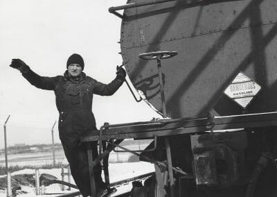 """Gordon Parks, Portland Maine, February, 1944, Vintage silver gelatin print, 9 1/2 x 7 1/2 in., Label adhered reading: """"Parks Portland, Me. Feb.,1944 2684 Switching a car for a load of high octane gas at the Portland Bulk Plant."""" Please credit Standard Oil Co. (N.J.) Photo By Parks stamp, Please return unused photos to Standard Oil Co. (N.J.)  Public Relations Dept, 30 Rockefeller Plaza New York, 20, New York stamp, annotated """"2684"""" in black ink three times, annotated """"PF24408"""" in pencil on verso."""