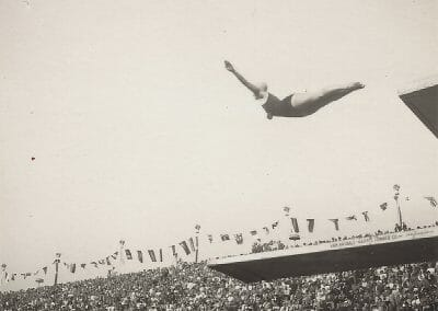 Leni Riefenstahl, Untitled (Diver at the 1936 Olympics), 1936, Vintage silver gelatin contact print on mount, 1 15/16 x 2 in., Photographer's initials embossed in blind stamp on mount on recto.